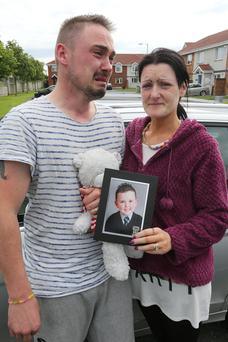 The distraught parents of little Jake Brennan (6), Christopher and Roseann Brennan pictured at Lintown Grove, where he died after a road accident there yesterday.
