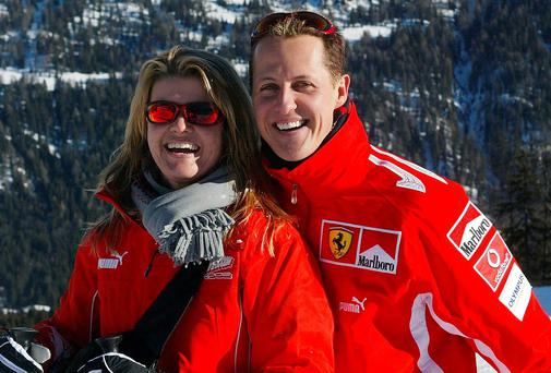 Michael Schumacher poses with his wife Corinna before the tragic fall