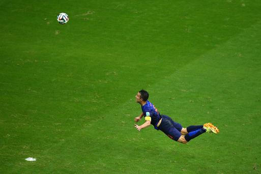 Robin van Persie scores Holland's first goal against Spain with a stunning diving header over Iker Casillas. Photo: Getty Images