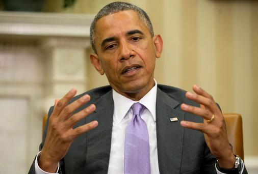 President Barack Obama warned leaders in Baghdad there would be a price for US military support and that things could not go on as before