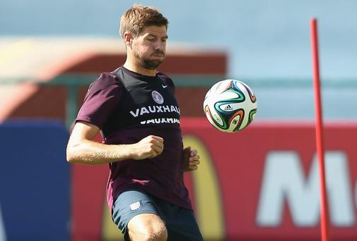 Steven Gerrard has vowed that England will not 'sit back and camp out on the edge of our box' against Italy tonight. Photo: Richard Heathcote/Getty Images