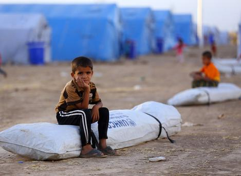 Iraqi refugee children from Mosul sits at Khazir refugee camp outside Irbil, 217 miles (350 kilometers) north of Baghdad, Iraq. (AP Photo)