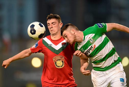 Brian Lenihan (L) in action against Shamrock Rovers