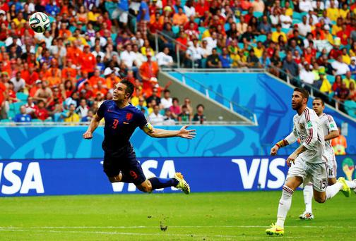 Robin van Persie scores a stunning header for Holland over the head of Spain goalkeeper Iker Casillas in their World Cup Group B opener. Photo: REUTERS/Michael Dalder