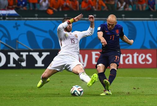 Arjen Robben strikes past Sergio Ramos to score Holland's second goal against Spain, putting his side ahead. Photo: David Ramos/Getty Images