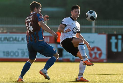 Dundalk's Richie Towell has eyes only for the ball as James Chambers comes in to challenge him at Oriel Park