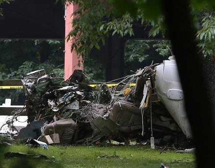 The wreckage of the small plane sits in the yard of a Purchase home in New York. (AP Photo/The Journal News, Frank Becerra Jr.)