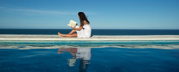 Relaxing by the pool: No matter what the weather, a good book will always provide some welcome relaxation