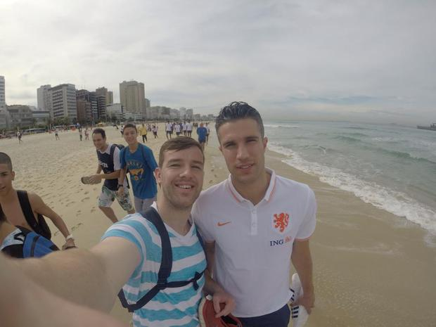 Michael snapping a selfie with Van Persie in Brazil