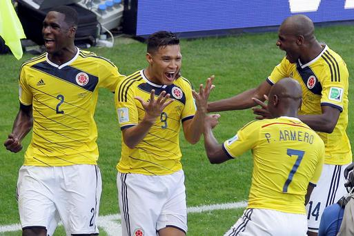 Colombia's Teofilo Gutierrez celebrates with teammates Cristian Zapata, Pablo Armero and Victor Ibarbo, after scoring against Greece