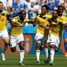 Colombia's Pablo Armero celebrates his goal against Greece with his teammates