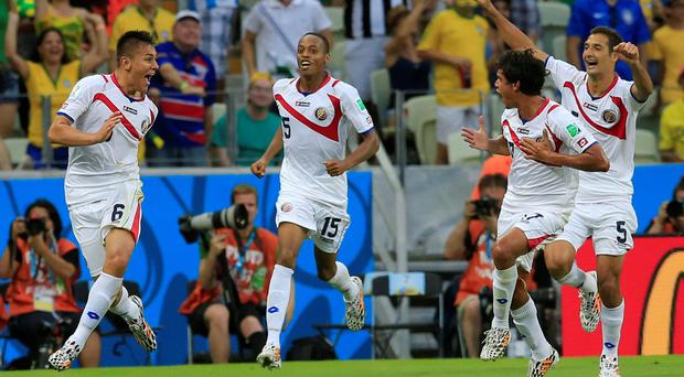 Costa Rica's Oscar Duarte celebrates after scoring his side's second goal against Uruguay in Fortaleza, Brazil