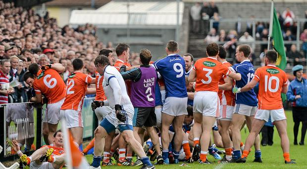 Players from both sides involved in a disagreement before the pre-match parade. Ulster GAA Football Senior Championship, Quarter-Final, Armagh v Cavan, Athletic Grounds, Armagh. Picture credit: Ramsey Cardy / SPORTSFILE