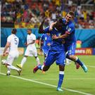 Mario Balotelli and Marco Verratti celebrate after Italy's second goal against England during 2014 World Cup