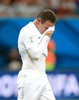 England's Wayne Rooney looks dejected during the defeat to Italy