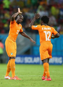 Wilfried Bony of the Ivory Coast (R) celebrates scoring his team's first goal with Sol Bamba during the 2014 FIFA World Cup Brazil Group C match between the Ivory Coast and Japan at Arena Pernambuco on June 14, 2014 in Recife, Brazil. (Photo by Julian Finney/Getty Images)