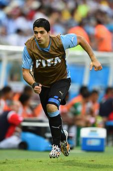 Luis Suarez of Uruguay warms up on the sideline during the 2014 FIFA World Cup Brazil Group D match between Uruguay and Costa Rica at Castelao