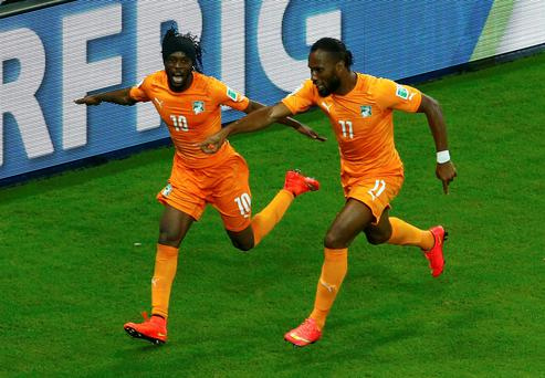 Ivory Coast's Gervinho and Didier Drogba celebrate their goal against Japan during their 2014 World Cup