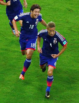 Japan's Keisuke Honda celebrates with teammates after scoring a goal during last nights Ivory Coast and Japan game