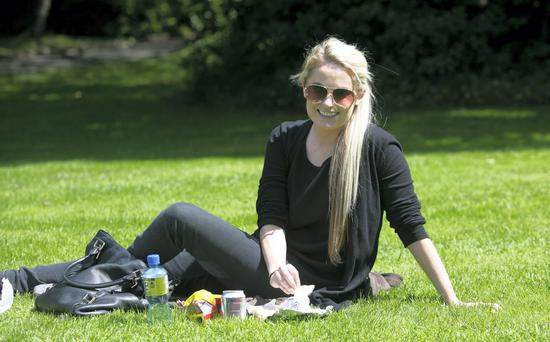 Niamh Joyce from Rathfarnam enjoying the good weather on Merrion Square, Dublin. Photo: Gareth Chaney Collins