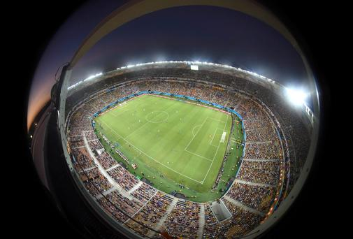 In this photo taken with a fisheye lens the teams run over the pitch during the group D World Cup soccer match between England and Italy at the Arena da Amazonia in Manaus, Brazil