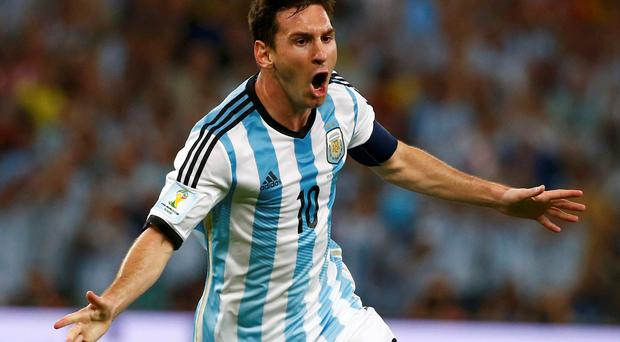 Argentina's Lionel Messi celebrates scoring a goal against Bosnia during their 2014 World Cup Group F soccer match at the Maracana stadium in Rio de Janeiro