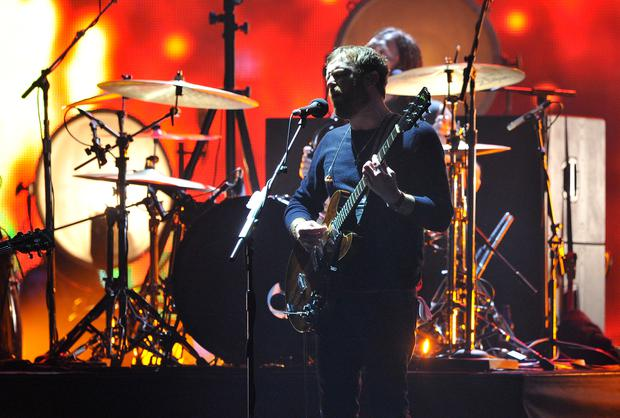 AMSTERDAM, NETHERLANDS - NOVEMBER 10: Caleb Followill of Kings of Leon performs onstage during the MTV EMA's 2013 at the Ziggo Dome on November 10, 2013 in Amsterdam, Netherlands. (Photo by Gareth Cattermole/Getty Images for MTV)