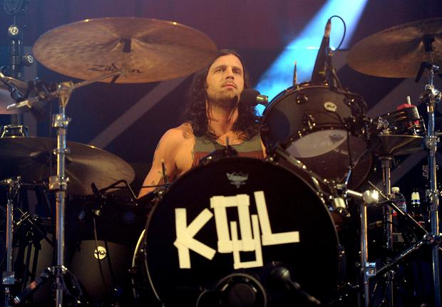 LOS ANGELES, CA - DECEMBER 07: Musician Nathan Followill of Kings of Leon performs onstage during The 24th Annual KROQ Almost Acoustic Christmas at The Shrine Auditorium on December 7, 2013 in Los Angeles, California. (Photo by Kevin Winter/Getty Images for Radio.com)