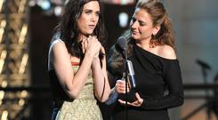 Actors Kristen Wiig and Annie Mumolo accept an award onstage at The Comedy Awards 2012 at Hammerstein Ballroom on April 28, 2012 in New York City.