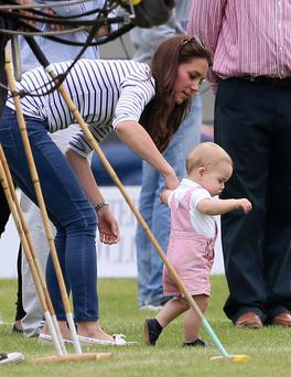 Catherine, Duchess of Cambridge and Prince George attend the Royal Charity Polo during the Maserati Jerudong Trophy at Cirencester Park Polo Club yesterday in England. (Photo by Chris Jackson/Getty Images for La Martina)