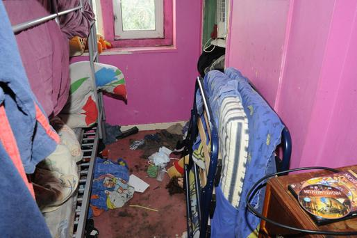 One of bedrooms in the house. Nine children lived in bedrooms that smelled of urine and animal faeces and mattresses were soiled, Gloucester Crown Court heard. Photo: Gloucestershire Police/PA Wire