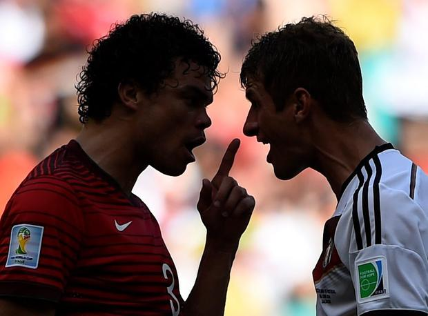 Portugal's Pepe argues with Germany's Thomas Mueller (R) before being red-carded