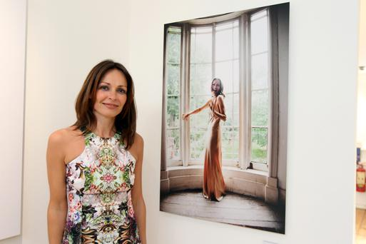 15/5/12 Sharon Corr with her photo at the opening of photographer Barry McCall's exhibition Pho20graphy, at the Copper House Gallery, Dublin. Picture:Arthur Carron/Collins
