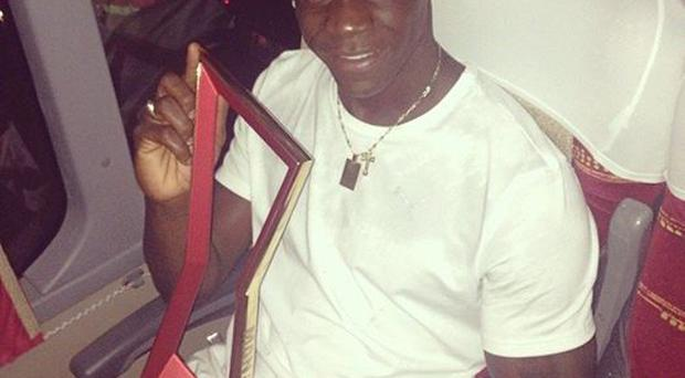 Mario Balotelli with his man of the match award following Italy's 2-1 win over England