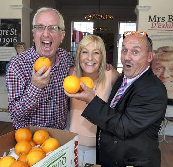 Brendan O'Carroll (right) with Mrs Brown's Boys co-stars Rory Cowan and O'Carroll's wife Jennifer Gibney at the opening of the Mrs Brown exhibition yesterday