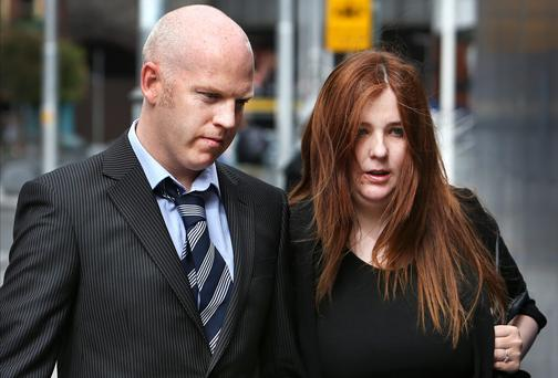 Francis Flynn and Fiona Watters, the parents of baby Jamie, at Coroner's Court. Photo: Steve Humphreys