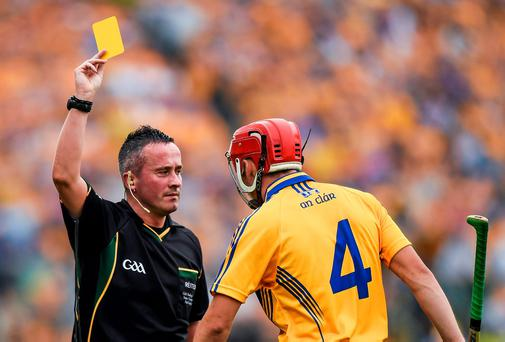 Referee James McGrath issues a yellow card to Clare's Jack Browne late in the first half of the Munster Hurling Senior Semi-Final between Clare v Cork