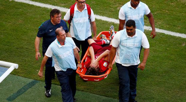 Fabio Coentrao of Portugal is stretchered off the field after an injury during the 2014 FIFA World Cup Brazil Group G match between Germany and Portugal at Arena Fonte Nova in Salvador, Brazil. (Photo by Matthew Lewis/Getty Images)