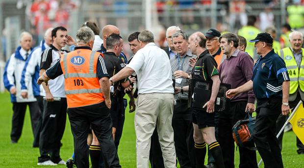Clare selector Mike Deegan confronts referee James McGrath at half time during the Munster GAA Hurling Senior Championship Semi-Final between Clare and Cork on Sunday. Picture credit: Dáire Brennan / SPORTSFILE