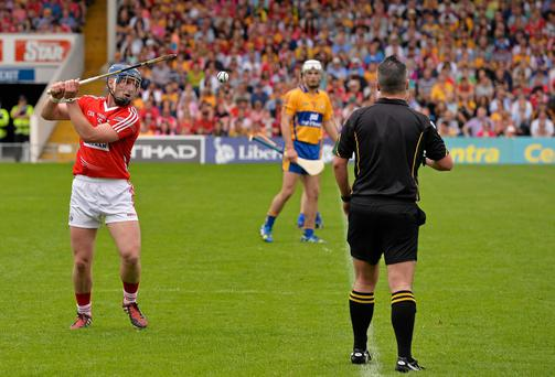 Referee James McGrath watches as Patrick Horgan, who scored 2-11 from placed balls for Cork, takes a 21 meter free. Munster GAA Hurling Senior Championship, Semi-Final, Clare v Cork, Semple Stadium, Thurles, Co. Tipperary. Picture credit: Ray McManus / SPORTSFILE