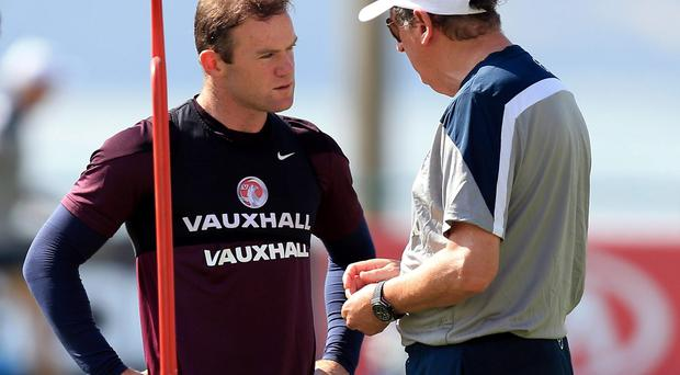 England manager Roy Hodgson with Wayne Rooney during a training session at the Urca Military Training Ground in Rio de Janeiro