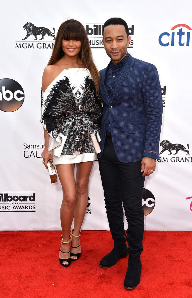 LAS VEGAS, NV - MAY 18: Model Christine Teigen (L) and musician John Legend attend the 2014 Billboard Music Awards at the MGM Grand Garden Arena on May 18, 2014 in Las Vegas, Nevada. (Photo by Frazer Harrison/Getty Images)