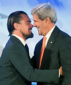 Secretary of State John Kerry introduces actor Leonardo DiCaprio to speak at the second day of the State Department's 'Our Ocean' conference at the State Department in Washington, Tuesday, June 17, 2014. President Barack Obama is looking to create the largest marine preserve in the world by protecting a massive stretch of the Pacific Ocean from drilling, fishing and other actions that could threaten wildlife, the White House said. (AP Photo/Cliff Owen)