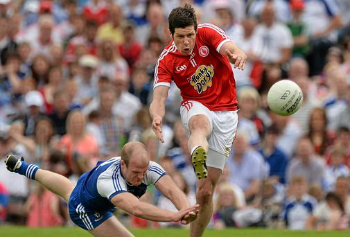 Sean Cavanagh, Tyrone, in action against Dick Clerkin, Monaghan