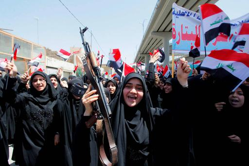 Iraqi Shiite women shout slogans support Iraqi army in Najaf, south of Baghdad. Iraq's Shi'ite rulers defied Western calls on Tuesday to reach out to Sunnis to defuse the uprising in the north of the country, declaring a boycott of Iraq's main Sunni political bloc and accusing Sunni power Saudi Arabia of promoting 'genocide'. Reuters