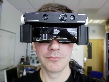 Dr Stephen Hicks, of the Nuffield Department of Clinical Neurosciences at Oxford University, testing 'smart glasses' that provide a new set of eyes for the visually impaired. PA