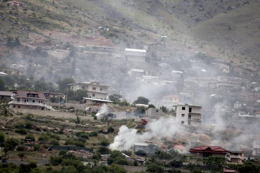 Smoke rises as police burn cannabis plants during a raid in the village of Lazarat. Reuters