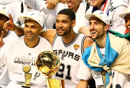 Tim Duncan (centre) with Tony Parker and Manu Ginobili of the San Antonio Spurs celebrate after defeating the Miami Heat in Game Five of the 2014 NBA Finals at the AT&T Center in San Antonio, Texas. (Photo by Andy Lyons/Getty Images)