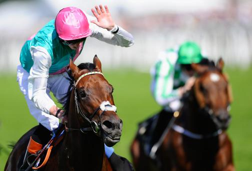 Jockey James Doyle riding Kingman wins the St James's Palace Stakes during day one of Royal Ascot at Ascot Racecourse in Ascot, England. Photo by Alan Crowhurst/Getty Images for Ascot Racecourse