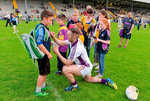 Supporters queue in line as Oisin Furlong, from the local Shelmaliers GAA Club, has his jersey signed by Wexford goalkeeper Mark Fanning long after the game had finished. Leinster GAA Hurling Senior Championship, Semi-Final, Wexford v Dublin, Wexford Park, Wexford. Picture credit: Ray McManus / SPORTSFILE